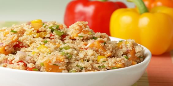 colorful healthy salad of quinoa, multiple varieties of peppers